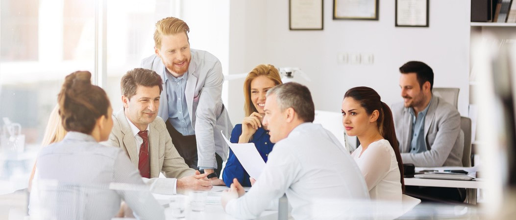 Picture of a group of people talking around a table